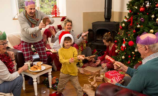 Unwrapping presents Holiday morning