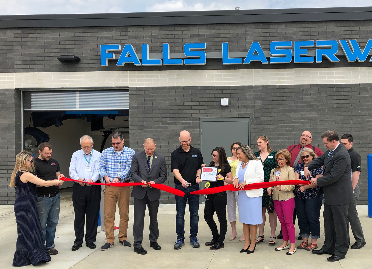 Falls-Laserwash-ribbon-cutting